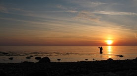 Evening fishing - The angler stands as a silhouette against the setting sun. It\'s a cliche, but it can look really nice