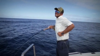 Striking hard - Fishing for tuna requires some determined hook setting as it can be seen here