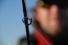 Detail and backdrop - People, anglers, nature or almost anything else will give a nice backdrop for a rod detail like this shooting eye