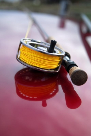 Car roof reflections - The color and reflections makes a nice picture of this reel and rod