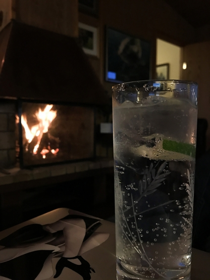 A drink by the fireplace