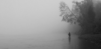 Angler in the mist - Ole probing the water close to the bank with his spey rod and leech fly on a misty morning on the Skeena.