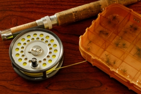 Rod, reel, & dry fly box still life -
