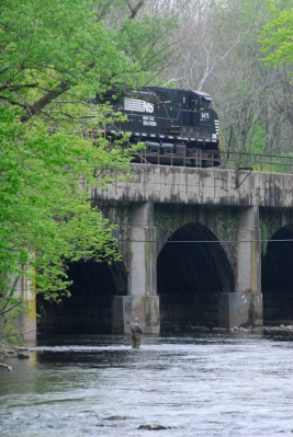 Train and angler.  Little Juniata River, PA -