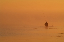 Orange - This angler and the rock are the only things standing out in this fabulous misty sunrise.