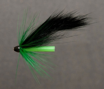 The Bag Fly - The Bag Fly is a very simple tube fly. You vary the volume and length of the wing by choosing a different fur - not by cutting the strip longer. Notice again how the base of hackles and wings are hidden under the cone.