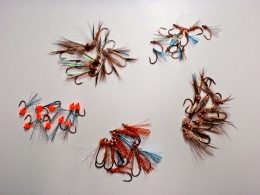 Pacific Salmon flies - A bunch tied up and ready for the pinks and cohos of BC - Rolled Muddlers to the right