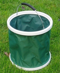 Garden bucket - A collapsible bucket like this one is available from many outlets at prices ranging from about 10 USD. Remove the handle and glue some heavy rubber to its bottom, and you have an excellent stripping basket for boat use.