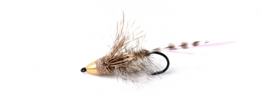 An early bullet muddler - Early on in my muddler career I started adding cones and bullets to the deer hair flies This later developed in to my Full Metal Jacket Nutria Muddler