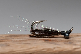 Mundane Crazy Dane with herl - If you want a darker body peacock herl is perfect for any saltwater fly