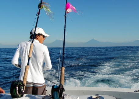 Volcanos on the horizon - Volcanos on the horizon as Ronald prepares to put teaser lines into the water; 12 wt and 10 wt. at the ready.