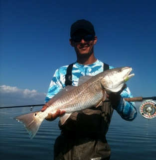 The author with a redfish - Caught on the Redfish Puff