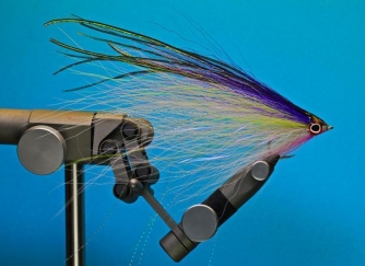Pete Gray baitfish - A simple fanned-out style fly with sparse bucktail, flash and herl, rendering a very life-like baitfish imitation. Notice the size of the hook compared to the apparent size of the fly.