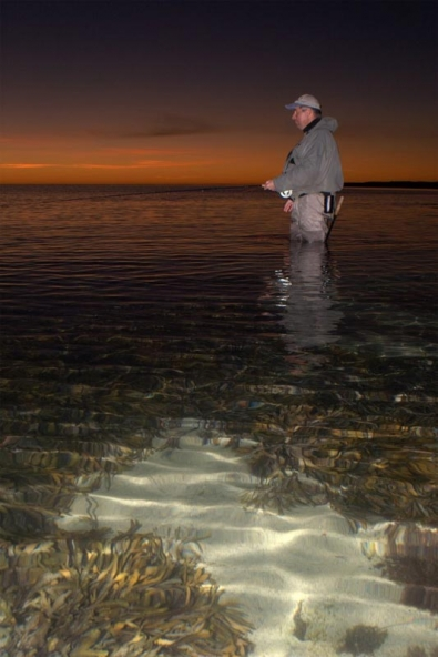 Sunset and clear water - Nailing a scene like this can be a lucky puch. The balance between the flash on the foreground, the angler and exposing the sky perfectly too might cost a few tries