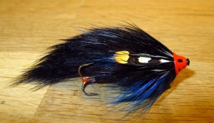 Black Gjaldbaek - This pattern is a very typical Danish seatrout and salmon fly. Lots of volume, dominated by black and with some contrasty accents