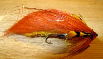 Karup-style, orange - Danish river Karup is known for night fishing for seatrout where flies with lots of volume work well. The flat disk will make the materials work in the current