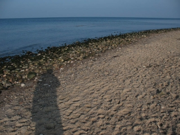 Long shadows - The sun is low, but is still nice and warm - as is the sight of a stretch of coast like this