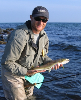Ready to release - Danish jari Wiklund is ready to release a Summit sea trout