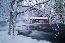 Cabin on the winter stream - A cold view of the river