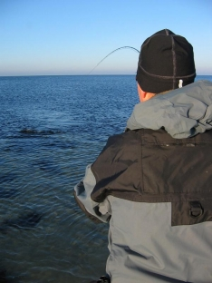 Standard over the shoulder - By standing behind the angler, you get a nice being-there perspective
