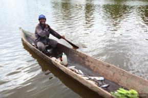 A local angler - Narrow wooden canoes is the boat type used by the locals