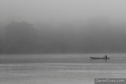 Misty - A local canoe striding across the water