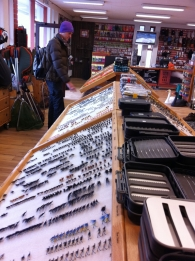 In the local shop - Morten assessing the commercial goods in a local flyshop
