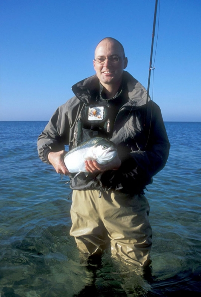 The author - GFF partner Martin Joergensen with a large sea run rainbow trout that could not resist a small Klympen.