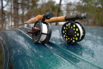 Ambiance - Rain, forest, reels, rods. Who doesn't want to go fishing when looking at this?