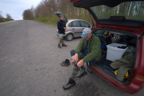 Gearing down - In lack of a comfortable chair, the back of a car can provide a seat and a little dignity while getting out of the waders.