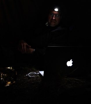 Reviewing today\'s catch - Niels Vestergaard at the computer after a day of fishing and filming