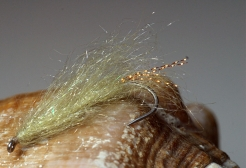 Olive Fluff - Olive and a streak of flash in the tail could imitate both a small baitfish and a shrimp