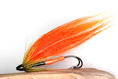 Orange Racoon - This fly consists of a bare tube, one racoon zonker strip and a straw of flash for a wing, and a front hackle. The cone finishes the front, and a bright junction tube the rear.