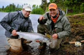 A happy moment - A happy moment with a good friend and a 15 lbs salmon. Angler Jerkko Ahtinen on the right got some help in landing from Markku Kemppainen.