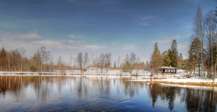 A beautiful sunny day - Beautiful sunny day on the river Läsäkoski. An idyllic lodge, called Villa Lohi (Salmon) is situated by the river bank.