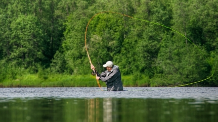 Two hand rods - Double hand rods and shooting heads are widely used on Byske. An angler is about to shoot his fly to distant honey holes.