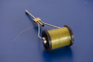 The narrow entrance - The hole in a normal bobbin holder isn\'t large and getting the thread through it can be a challenge