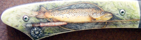 Brown trout and rod -