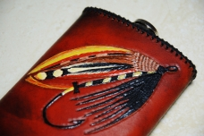 Flask with a classic salmon fly -