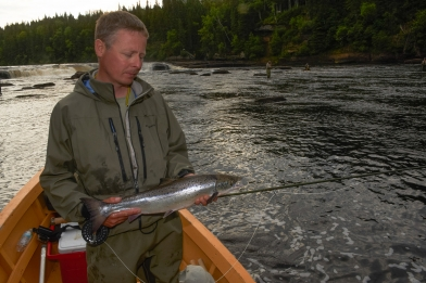 The author with a small salmon - Maybe not that big, but caught on a dry fly in hallowed waters of which he has dreamed since childhood.