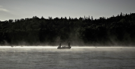 In the mist - A boat in the morning mist