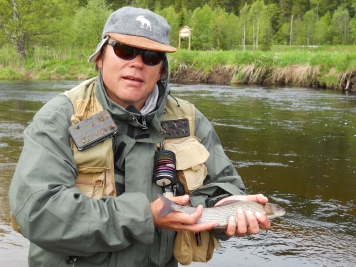 The author with a Norwegian grayling taken on an F&K Caddis -
