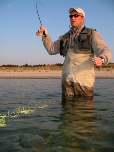 Right hand - Ken is a right hand caster and keeps the rod in the right hand while retrieving and fighting
