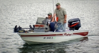 Boat #1 - The captain of Boat #1, Gary (seated) with his brother Doug (standing). Very nice boat - makes flying up and down the lake a breeze and the various trolling options always put the fisherman in great position to cast to shoreline structure.