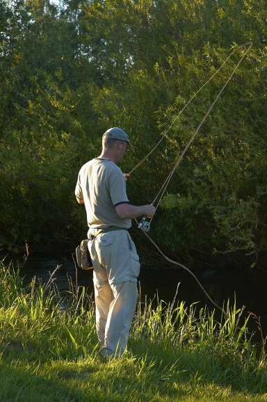 The author fishing - Myself fishing on a typical, Danish stream. On this particular day the Super Pupa produced a couple of grayling