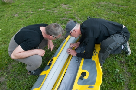 A leak - My kayak is inflatable, and here Rudiger and Paul are trying to locate a leak