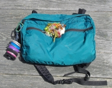 A conoe thwart pack - A large thwart, waist or fanny pack can be practical. It can attach to a thwart, your waist, the seat back, and many other places.