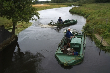 A curse - River keepers preparing for cutting the vegetation in a Danish river - ruining the fishing downstream for a day or two