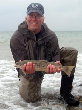A good reason to be happy - German/American Paul Kalbrenner carefully cradles a Danish sea trout