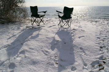 Winter sun - The sun makes the chairs cast a couple of nice shadows on the snow